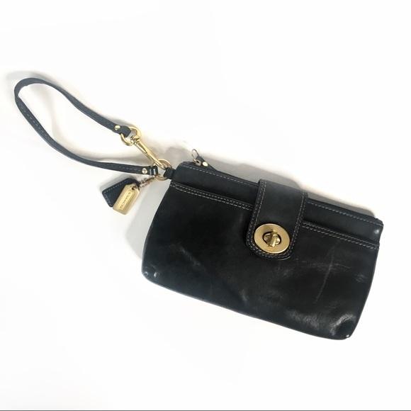 Coach Handbags - Coach black leather wristlet brass twist lock
